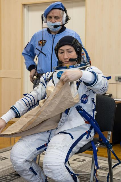 Astronaut Christina Koch suits up for a dress rehearsal in preparation for Expedition 59 to the ISS