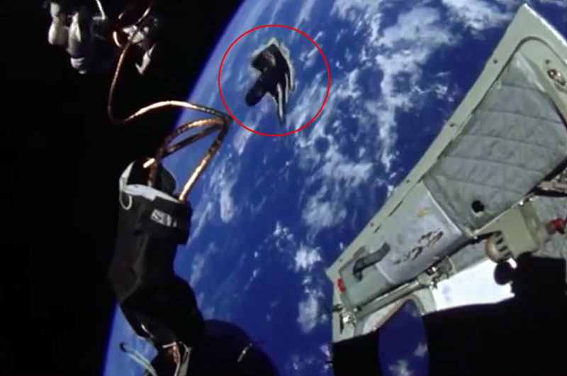 Glove floats out of Gemini IV capsule