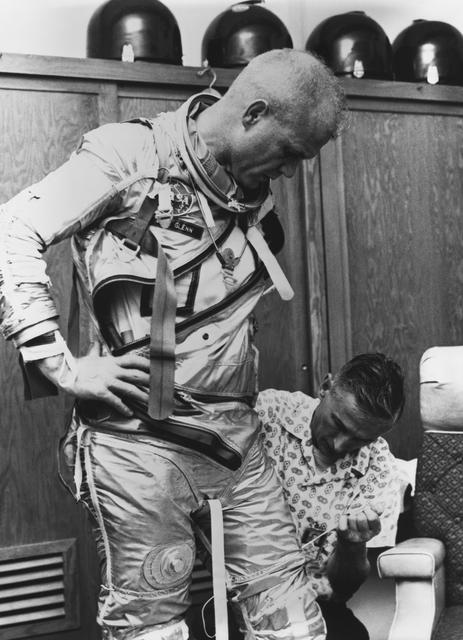 John Glenn practices suiting up for his Mercury-Atlas 6 (MA-6) flight