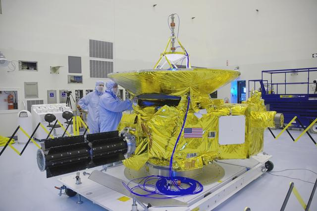 NASA's New Horizons spacecraft is housed inside a clean room at KSC.