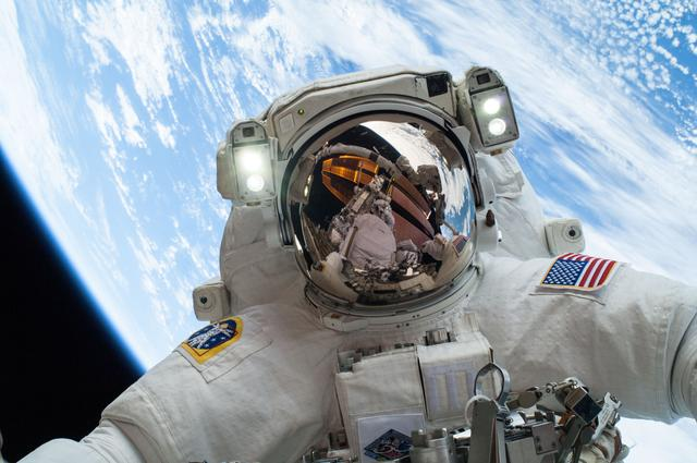 NASA astronaut and Expedition 38 crew member Mike Hopkins participates in an EVA.
