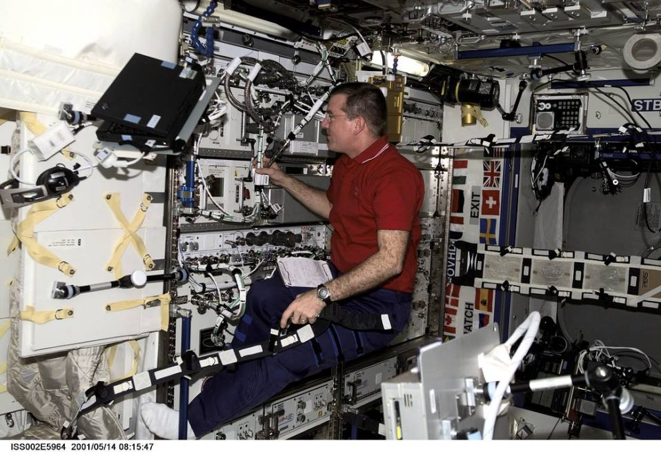 Expedition 2 crew member James Voss with EXPRESS rack 1
