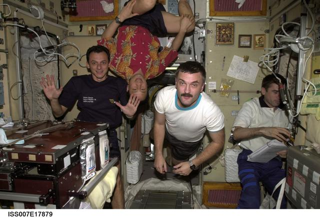 Expedition 7 and 8 crewmembers pause for photo in the Zvezda Service module