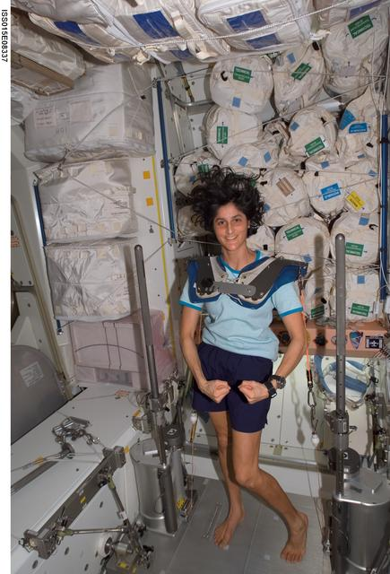 NASA astronaut Sunita Wiliams works out in the Unity node of the ISS using IRED equipment