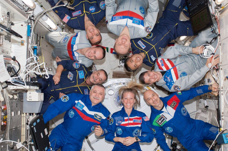 Expedition 37 and 38 crewmembers pose for a group photo onboard the ISS
