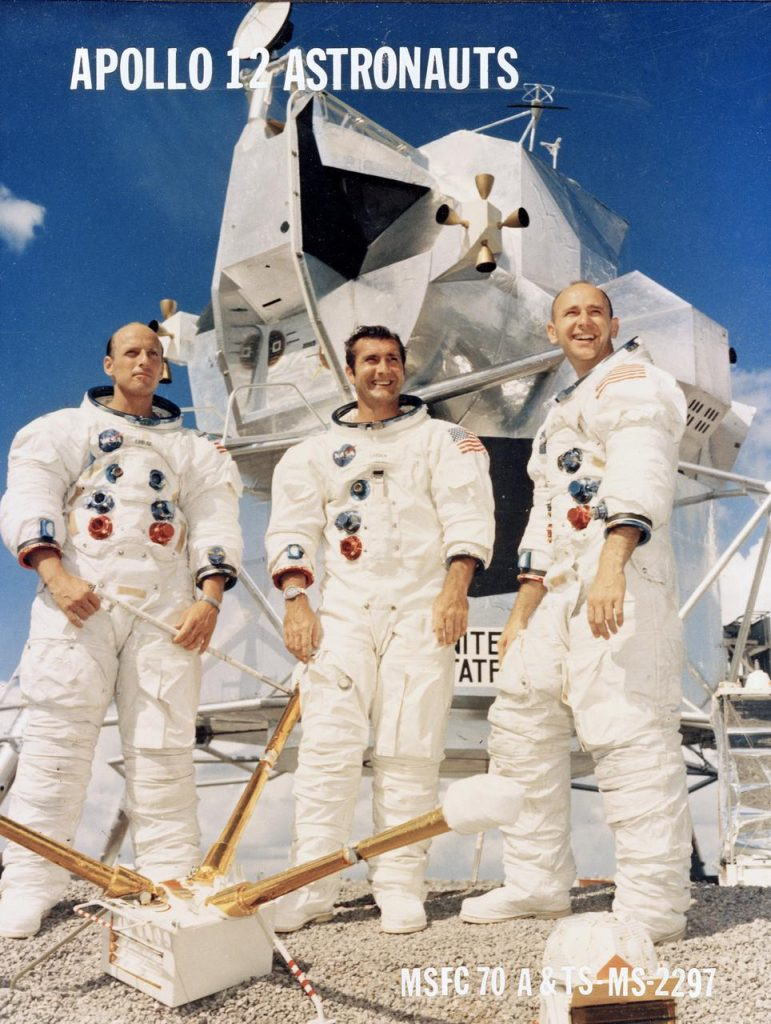he Apollo 12 three-man crew pictured left to right are: Astronauts Charles Conrad, Spacecraft Commander; Richard F. Gordon, pilot of the Command Module `Yankee Clipper'; and Alan L. Bean, pilot of the Lunar Module `Intrepid'.