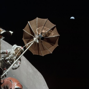 Schmitt photographs Cernan and the lunar rover with Earth in the background