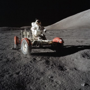 Cernan checks out the Lunar Roving Vehicle (LRV) on the surface of the Moon
