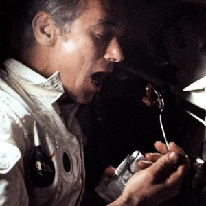 Apollo 17 commander Eugene Cernan enjoys a meal in space during the mission