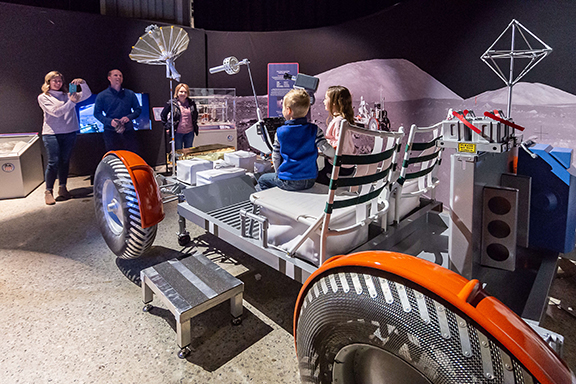 family on Lunar Rover model